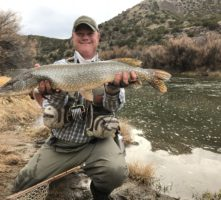 Andrew Black holds a northern pike he caught on the Rio Grande.