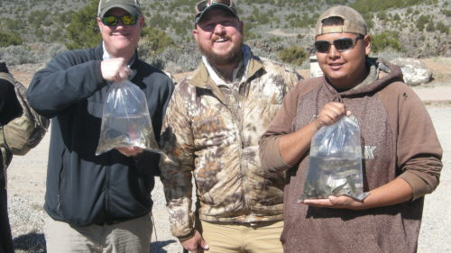 Andrew Black, left, of the NWF/NMWF holds a bag of Rio Grande cutthroat trout. Jesse Deubel, executive director of the New Mexico Wildlife Federation, stands in the middle. Eldon Crespin, a volunteer from Santo Domingo Pueblo, holds a bag of trout on the right.